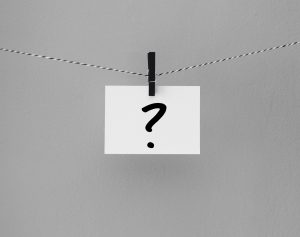 "The pic for the FAQ's page is a black and white string, with a black wooden clothespin hanging from it, holding an index card with a question mark on it. The picture equivalent of ""Whaaa?!"""