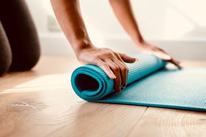 Unrolling a blue yoga mat... and a world of possibilities
