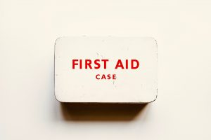 White metal first aid tin on a white background